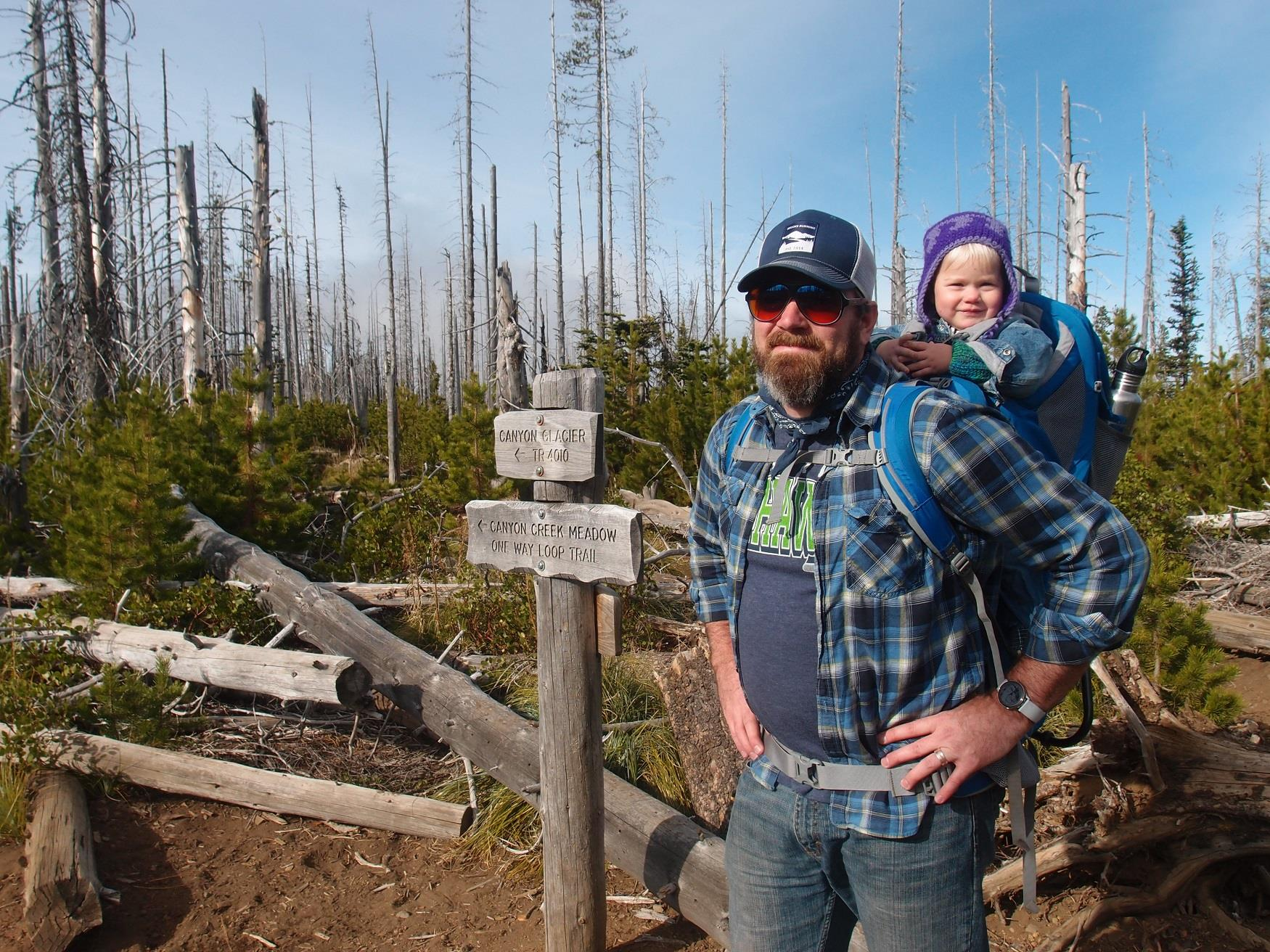 This is a father and daughter at the trailhead of the Canyon Creek Meadow Hike near Cold Springs Resort in Camp Sherman, Oregon