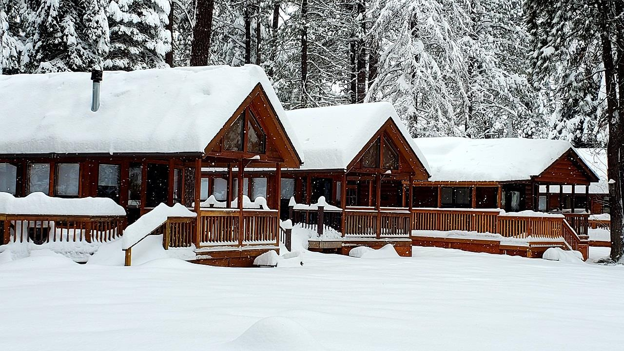 Three snow-covered cabins at Cold Springs Resort in Camp Sherman, OR