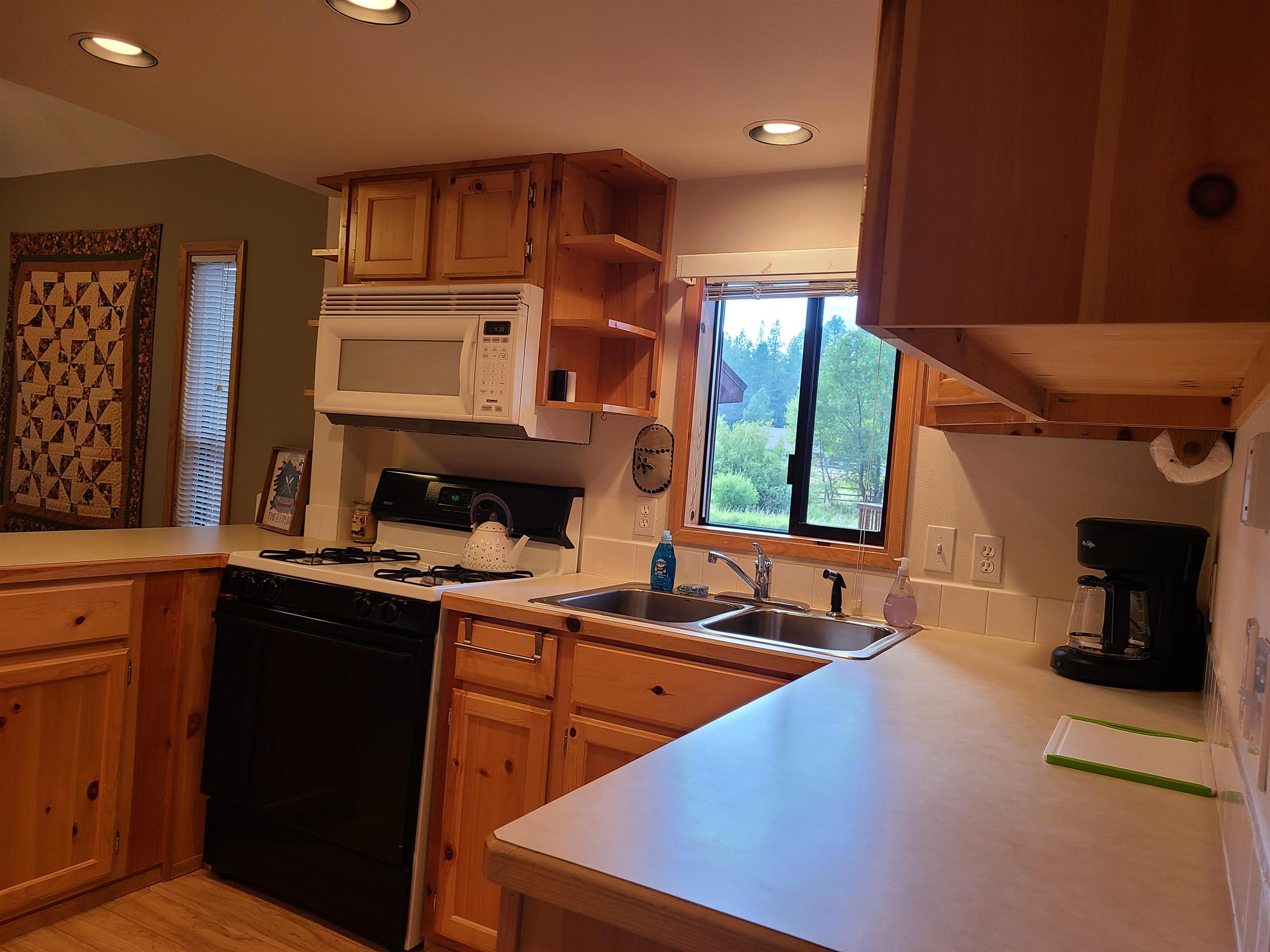 Cook up a delicious family dinner in the kitchen of Cottonwood Cabin at Cold Springs Resort & RV Park in Camp Sherman, Oregon