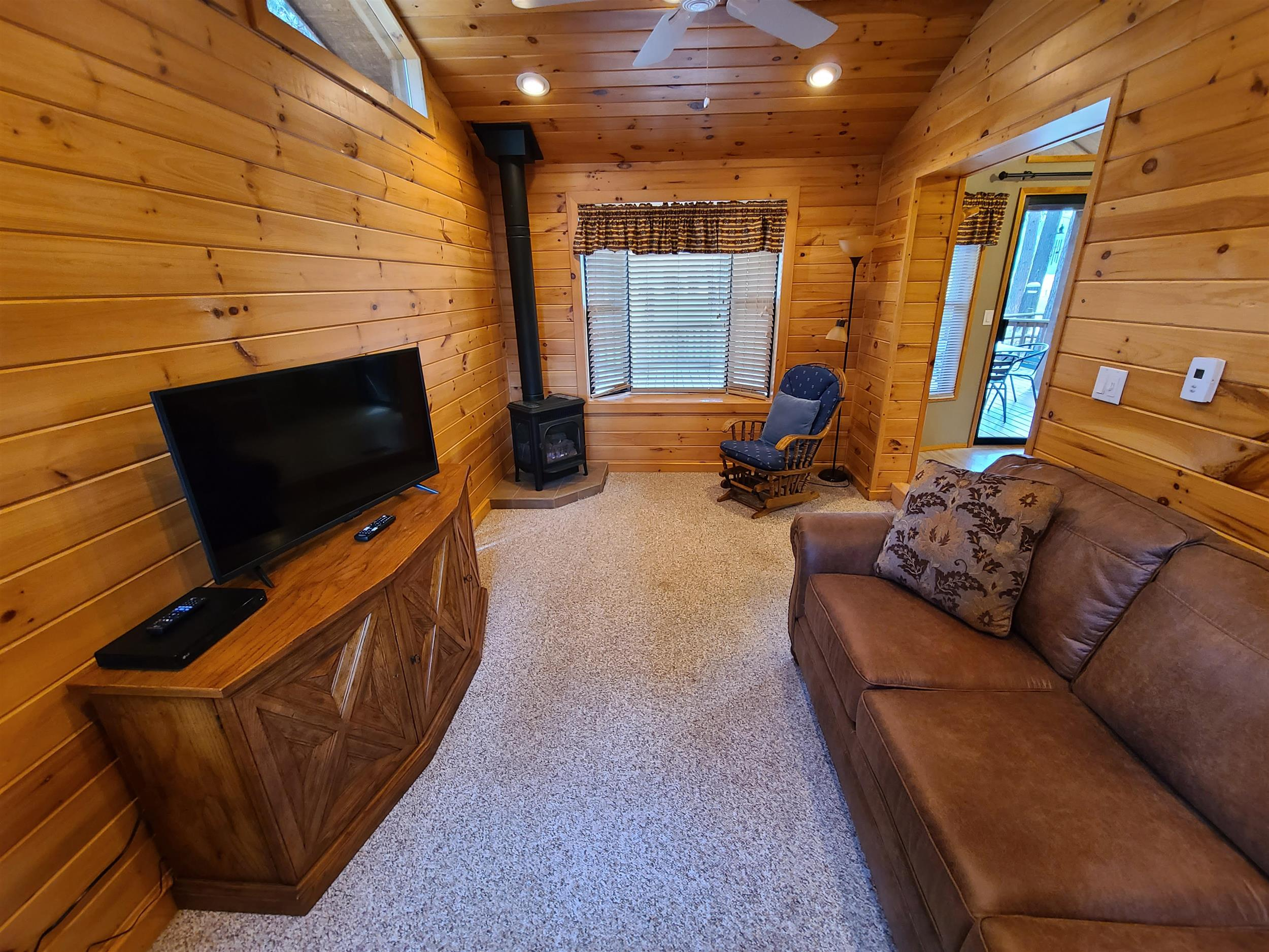 The cozy living room of Cottonwood Cabin at Cold Springs Resort & RV Park in Camp Sherman, Oregon