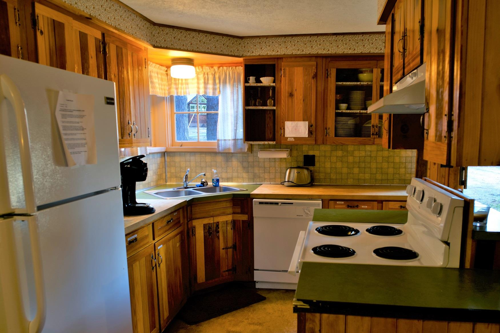 Cook up a delicious family dinner in the kitchen of Haberman Cabin at Cold Springs Resort & RV Park in Camp Sherman, Oregon