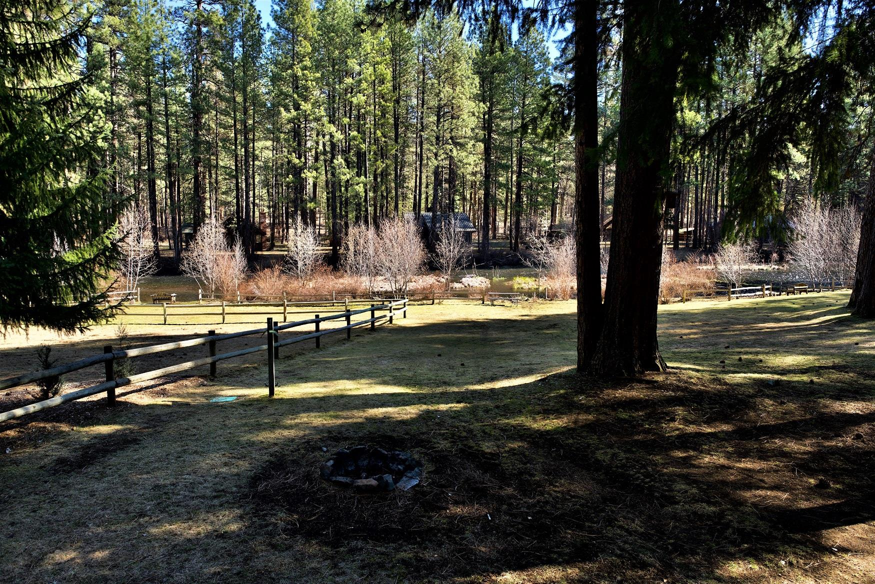 A perfect view of the Metolius River, off the deck of Riverview Cabin, at Cold Springs Resort in Camp Sherman, Oregon