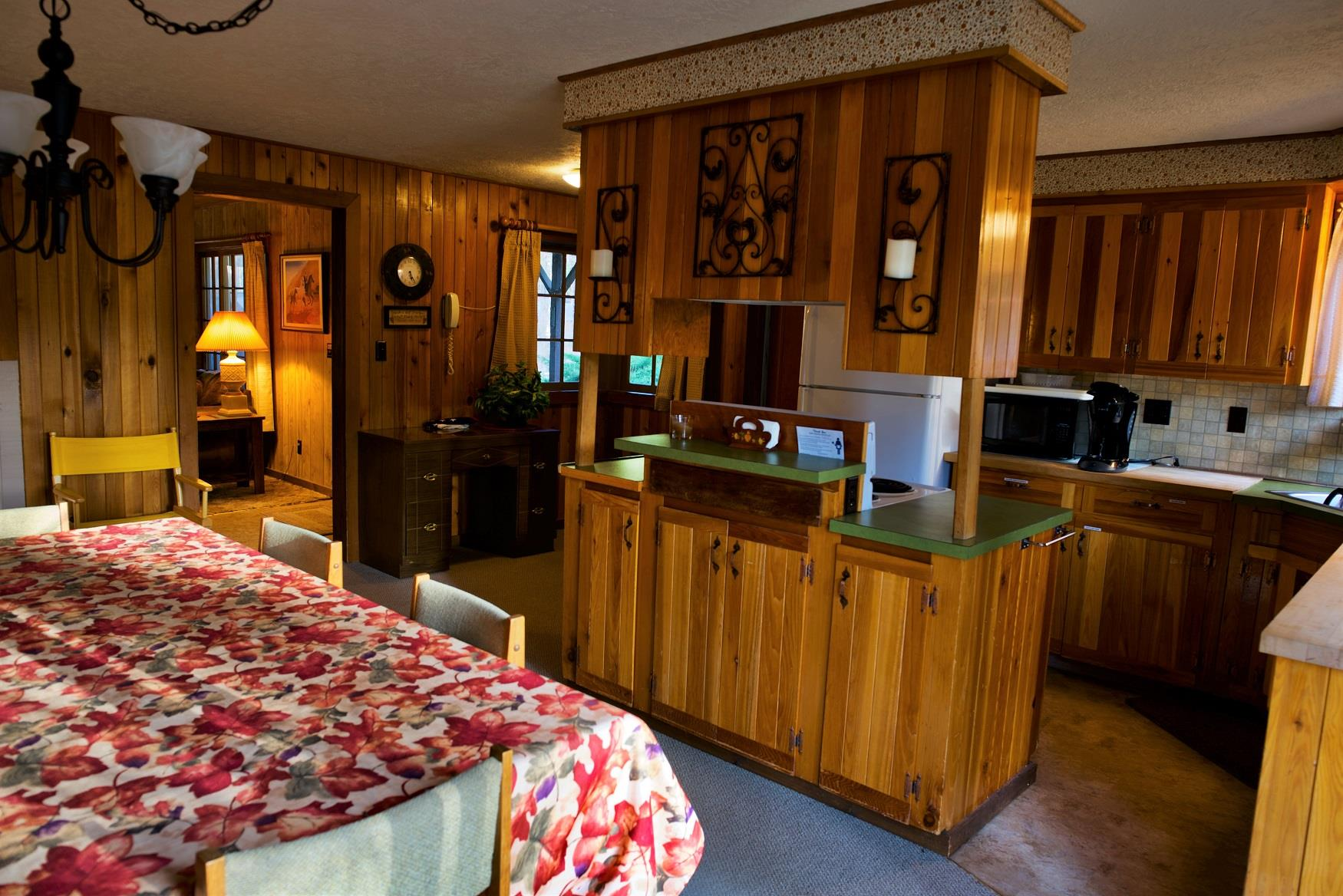 Serve up a delicious family dinner in the spacious dining and kitchen area of Haberman Cabin at Cold Springs Resort & RV Park in Camp Sherman, Oregon