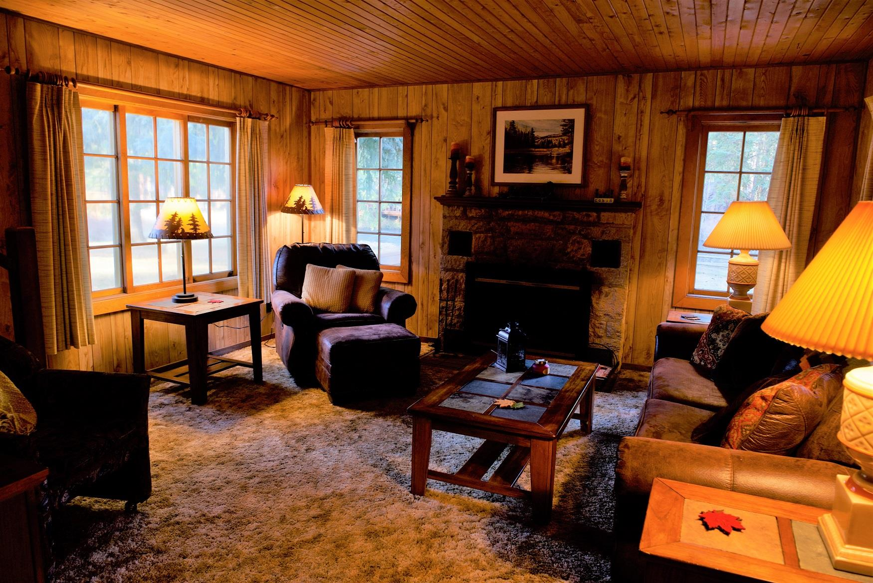 The cozy living room of Haberman Cabin at Cold Springs Resort & RV Park in Camp Sherman, Oregon