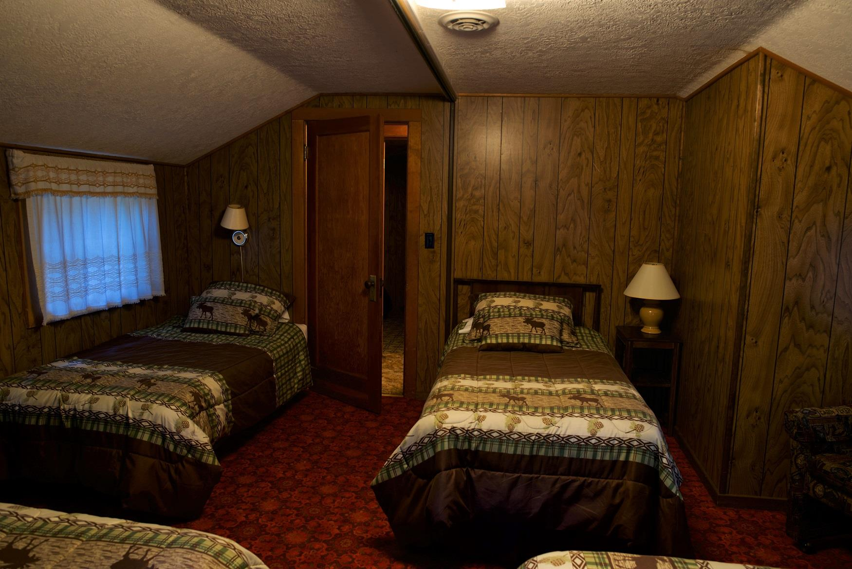 The kids will sleep tight tonight in the cozy upstairs sleeping area of Haberman Cabin at Cold Springs Resort, in Camp Sherman, Oregon