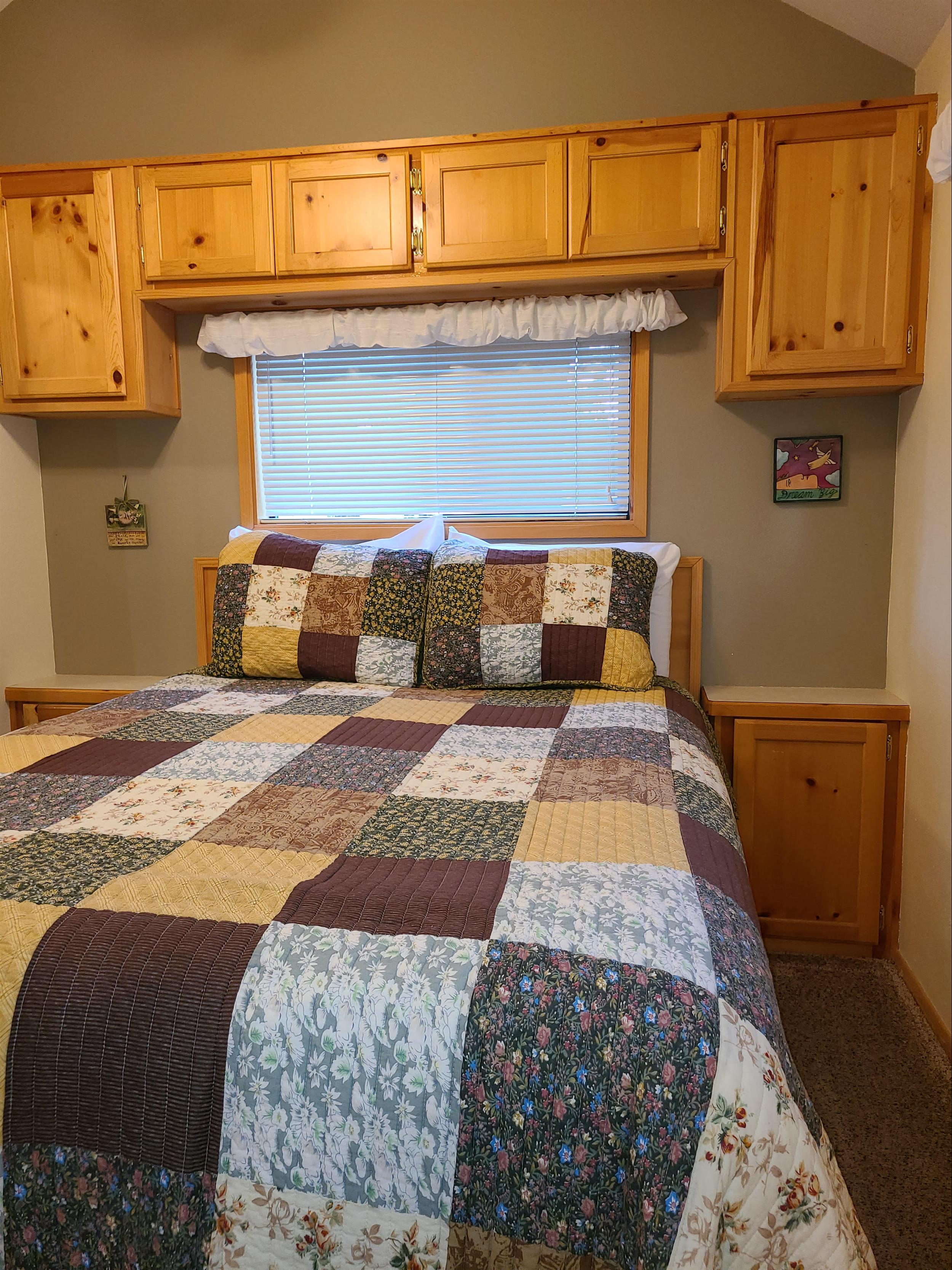The cozy bedroom of Cottonwood Cabin at Cold Springs Resort & RV Park in Camp Sherman, Oregon