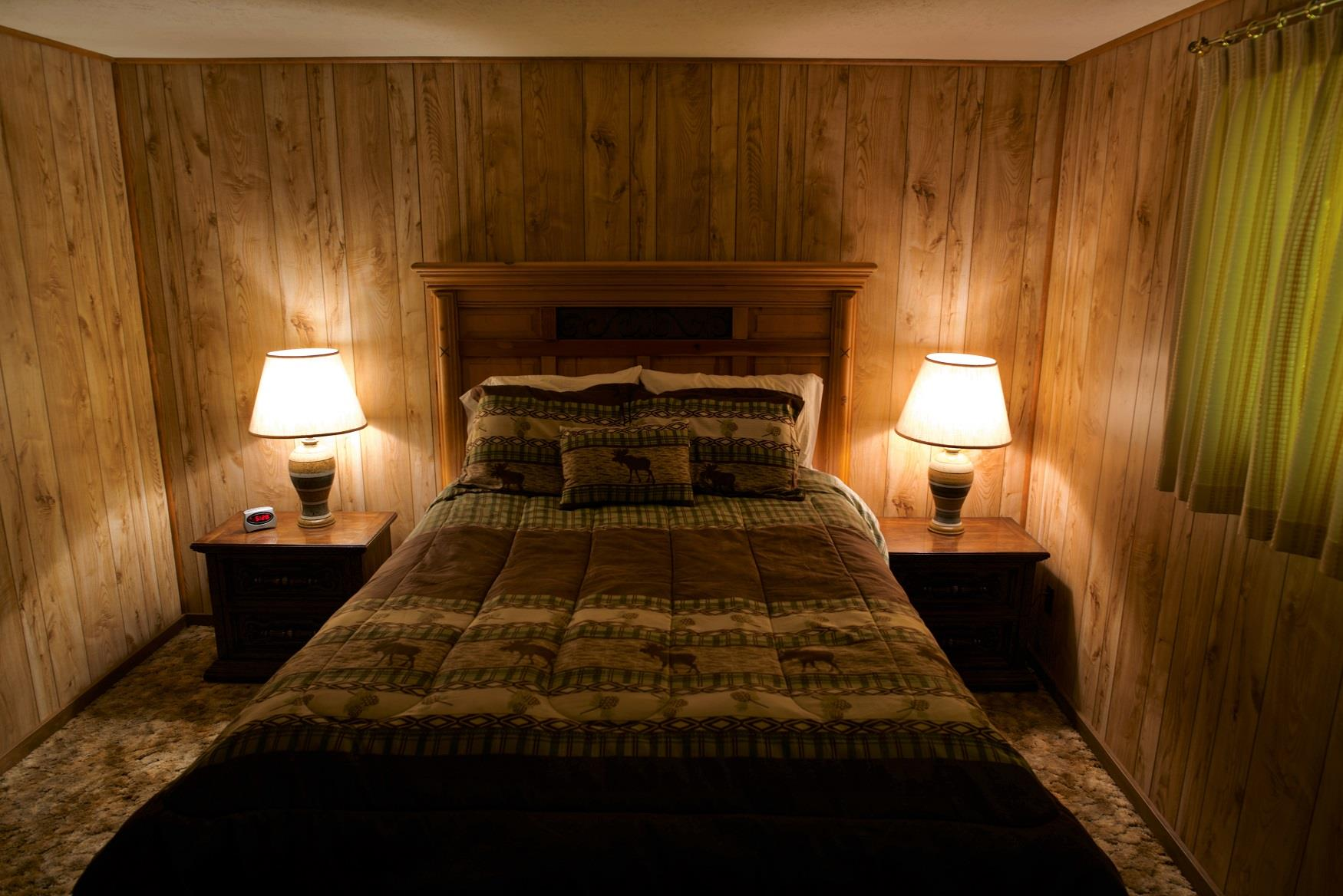 Get your best night sleep in the comfy queen bed in Haberman Cabin, at Cold Springs Resort & RV Park in Camp Sherman, Oregon
