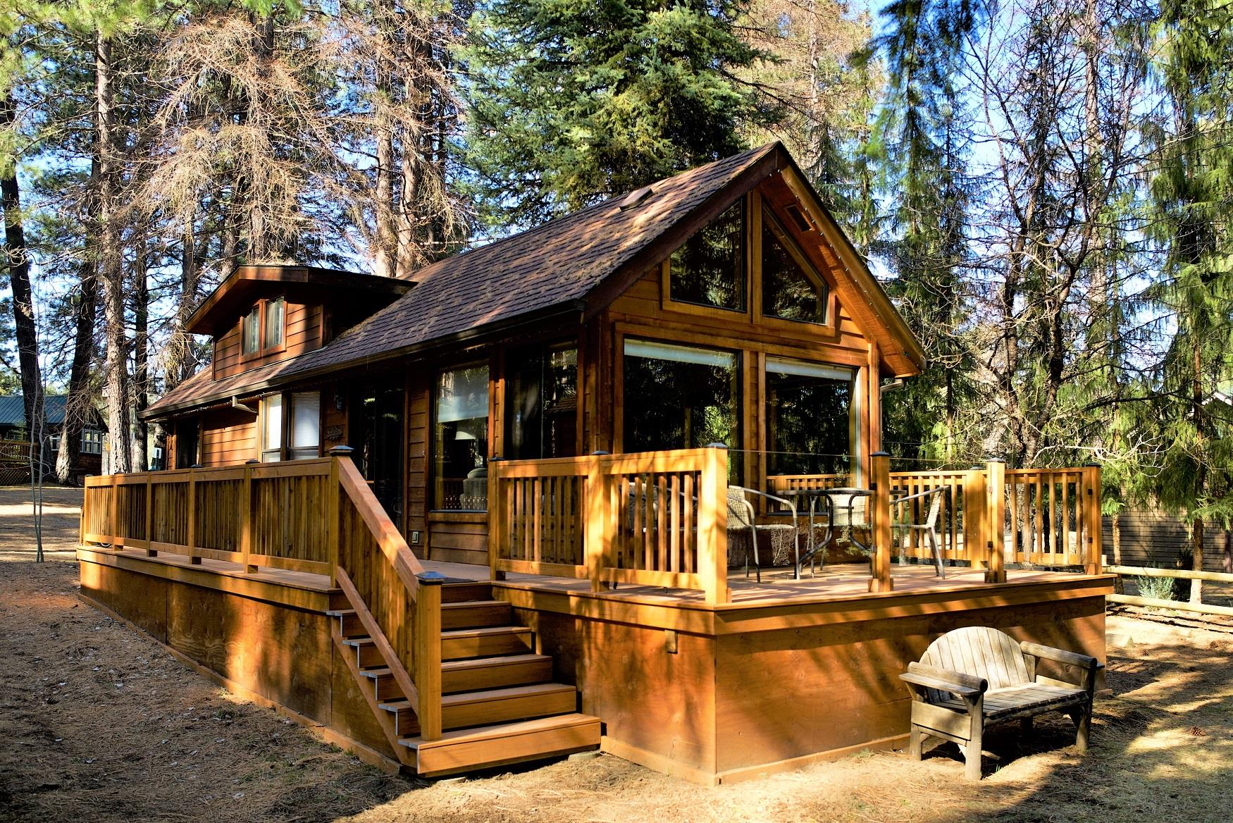 The spacious front deck of Riverview Cabin, at Cold Springs Resort, looks out directly onto the pristine Metolius River, in Camp Sherman, Oregon