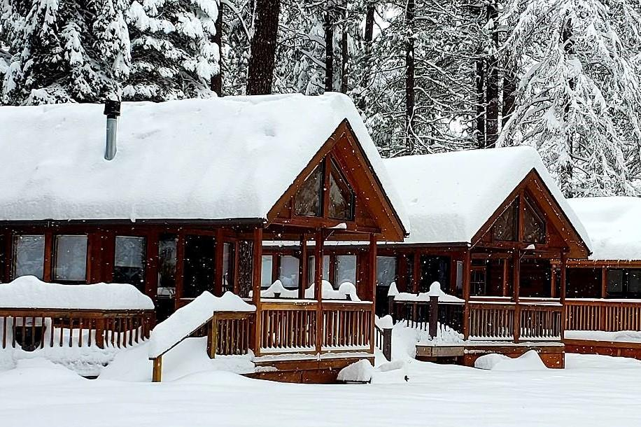 The cozy riverfront cabins at Cold Springs Resort, surrounded by forest and snow, Camp Sherman, Oregon